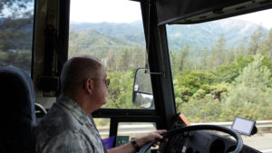 Wayne driving a tour bus through the beautiful Trinity Alps in Northern California.