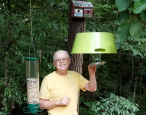 Wayne pauses to smile as he checks one of our bird feeders. Bird watching has become an important part of our quality of life.